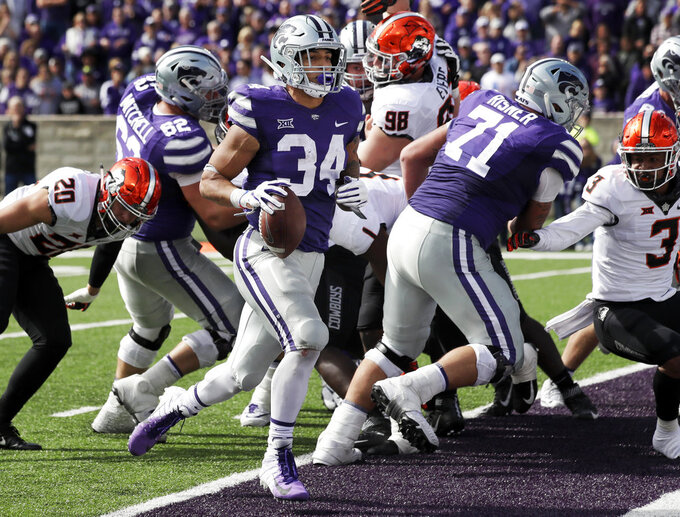 Kansas State running back Alex Barnes (34) scores a touchdown during the second half of an NCAA college football game against Oklahoma State in Manhattan, Kan., Saturday, Oct. 13, 2018. (AP Photo/Orlin Wagner)