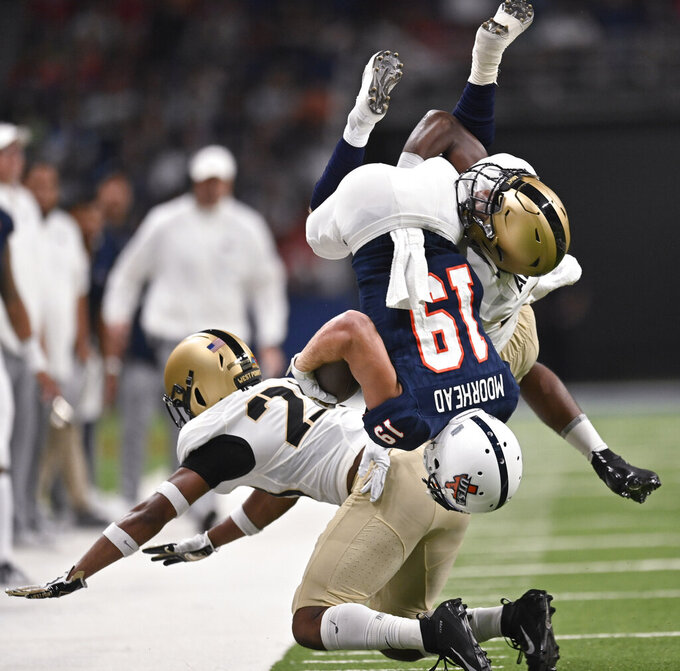 UTSA's Blaze Moorhead (19) is tackled by Army's Cedrick Cunningham, Jr., right, and Cam Jones during the first half of an NCAA college football game Saturday, Sept. 14, 2019, in San Antonio. (AP Photo/Darren Abate)