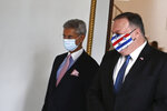 U.S. Secretary of State Mike Pompeo, right, and Indian Foreign Minister Subrahmanyam Jaishankar arrive to attend their meeting in Tokyo, Tuesday, Oct. 6, 2020, ahead of the four Indo-Pacific nations' foreign ministers meeting. (Charly Triballeau/Pool Photo via AP)