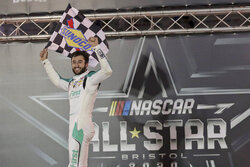 FILE - In this July 15, 2020, file photo, Chase Elliott celebrates after winning the NASCAR All-Star auto race at Bristol Motor Speedway in Bristol, Tenn. Texas is the third track in three years to hold NASCAR's All-Star race. Elliott won last summer at Bristol, where the annual non-points exhibition was moved from Charlotte because of COVID-19 restrictions. (AP Photo/Mark Humphrey, File)
