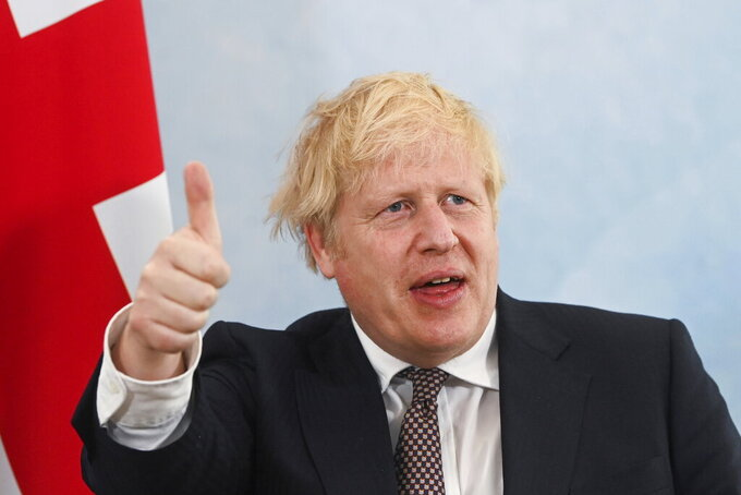 Britain's Prime Minister Boris Johnson gestures during a meeting with U.S. President Joe Biden (not pictured) ahead of the G7 summit, at Carbis Bay Hotel, Carbis Bay, Cornwall, Britain, Thursday June 10, 2021. (Toby Melville/Pool Photo via AP)