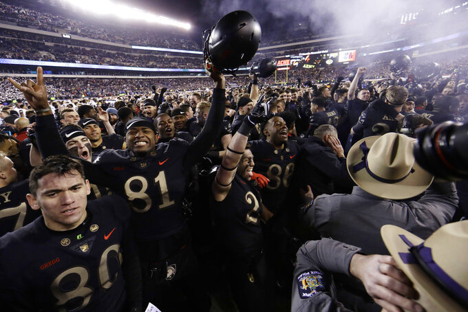 Army players celebrate after an NCAA college football game against Navy, Saturday, Dec. 8, 2018, in Philadelphia. Army won 17-10. (AP Photo/Matt Slocum)