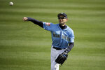 Seattle Mariners right fielder Ichiro Suzuki warms up in the outfield before the second inning of a spring training baseball game against the Oakland Athletics, Friday, Feb. 22, 2019, in Peoria, Ariz. (AP Photo/Charlie Riedel)