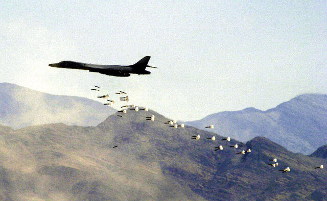 FILE - In this Friday, July 19, 2002, file photo, a U.S. Air Force B1-B bomber drops live bombs at the Nevada Test and Training Range in Indian Springs, Nev. Nevada's congressional Democrats gained backing from Gov. Steve Sisolak in a bid to block a measure to let the military widen boundaries of a vast U.S. Air Force bombing range in southern Nevada into a national wildlife refuge. The governor, a Democrat, joined U.S. Representatives Dina Titus, Steven Horsford and Susie Lee on Thursday, July 9, 2020, citing opposition to the idea by groups including the Moapa Band of Paiutes and the Las Vegas Paiute Tribe. (AP Photo/Joe Cavaretta, File)