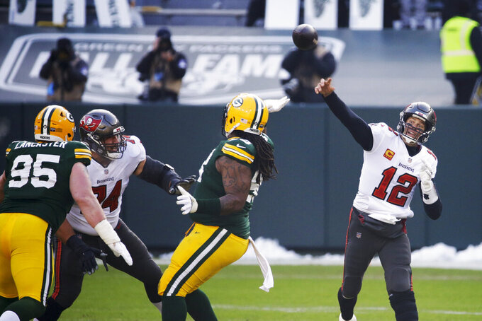 Tampa Bay Buccaneers quarterback Tom Brady (12) passes against the Green Bay Packers during the first half of the NFC championship NFL football game in Green Bay, Wis., Sunday, Jan. 24, 2021. (AP Photo/Mike Roemer)