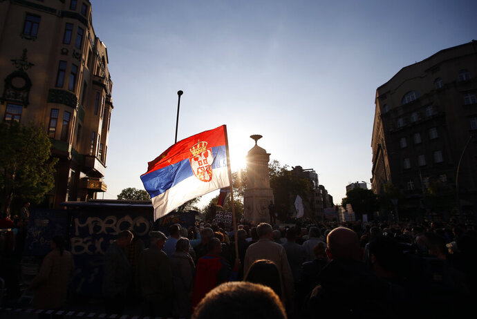 Protesters gathering at Terazije square during a protest against populist president Aleksandar Vucic in Belgrade, Serbia, Saturday, April 20, 2019. Thousands of people have rallied in Serbia's capital for 20th week in a row against populist President Aleksandar Vucic and his government. (AP Photo/Darko Vojinovic)