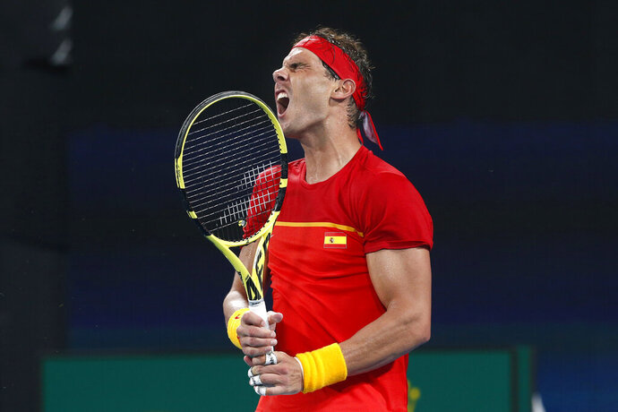 Rafael Nadal of Spain reacts to missing a shot against David Goffin of Belgium during their ATP Cup tennis match in Sydney, Friday, Jan. 10, 2020. (AP Photo/Steve Christo)