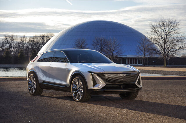 This photo provided by General Motors shows the Cadillac Lyriq. General Motors' Cadillac brand is the latest to roll out an electric vehicle with the promise of taking sales from market leader Tesla. Executives say the Lyriq midsize SUV will have a range of over 300 miles per charge as well as technology and features to pull buyers from Tesla.  (GM via AP)