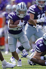 Kansas State running back Deuce Vaughn (22) run for a first down during the first half of an NCAA college football game against Nevada on Saturday, Sept. 18, 2021, in Manhattan, Kan. (AP Photo/Charlie Riedel)