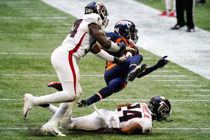 Denver Broncos wide receiver Jerry Jeudy (10) runs against Atlanta Falcons linebacker Foye Oluokun (54) and Atlanta Falcons cornerback A.J. Terrell (24) during the second half of an NFL football game, Sunday, Nov. 8, 2020, in Atlanta. (AP Photo/Brynn Anderson)
