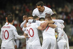 Portugal players celebrate after their teammate Cristiano Ronaldo scored their side's second goal during the Euro 2020 group B qualifying soccer match between Luxembourg and Portugal at the Josy Barthel stadium in Luxembourg, Sunday, Nov. 17, 2019. (AP Photo/Francisco Seco)