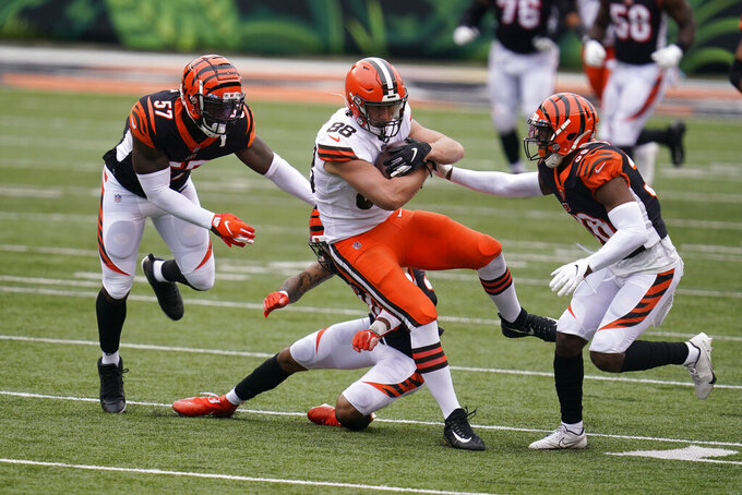 Cleveland Browns' Harrison Bryant (88) is tackled by Cincinnati Bengals' Germaine Pratt (57) and LeShaun Sims (38) during the second half of an NFL football game, Sunday, Oct. 25, 2020, in Cincinnati. (AP Photo/Michael Conroy)