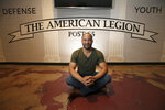 In this Tuesday, July 30, 2019 photo, activists Lawrence Robinson poses for a photograph at the Post 65 American Legion hall, formed during the era of segregation and recently renovated in Phoenix. Three American Legion posts stand within miles of each other in central Phoenix, a curious reminder of how segregation once ruled the U.S. Southwest as well as the Deep South. Decades later, tensions in Phoenix's minority communities remain, spilling over this summer after video of police officers pointing guns and cursing at a black couple revived disturbing memories of the days of segregation, when black and Hispanic residents recall commonly being mistreated by police.   (AP Photo/Ross D. Franklin)