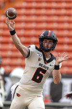 Oregon State quarterback Jake Luton (6) throws a pass doing pregame warmups before the start of an NCAA college football game against Hawaii, Saturday, Sept. 7, 2019, in Honolulu. (AP Photo/Eugene Tanner)