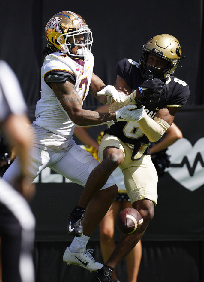 Colorado cornerback Mekhi Blackmon, right, is called for interference as Minnesota wide receiver Chris Autman-Bell tries to catch a pass in the second half of an NCAA college football game Saturday, Sept. 18, 2021, in Boulder, Colo. (AP Photo/David Zalubowski)