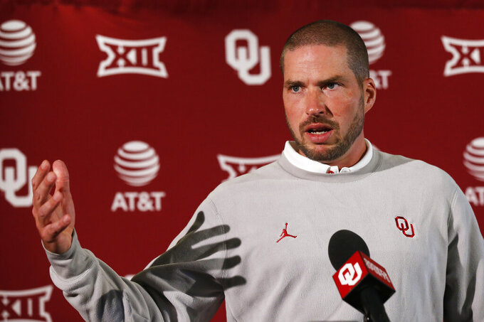 In this Aug. 2, 2019, photo, Oklahoma defensive coordinator Alex Grinch answers a question during the NCAA college football team's media day in Norman, Okla. Grinch, the man who previously rebuilt Washington State's defense and more recently was co-defensive coordinator at Ohio State, is bringing his aggressive approach to Oklahoma. (AP Photo/Sue Ogrocki)