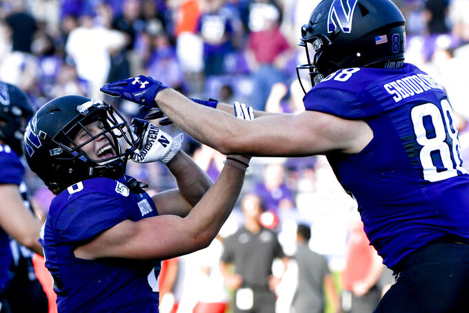 Northwestern running back Drake Anderson, left, celebrates with Northwestern wide receiver Bennett Skowronek (88) after Anderson scored a touchdown against UNLV during the second half of an NCAA college football game, Saturday, Sept. 14, 2019, in Evanston, Ill. (AP Photo/Matt Marton)