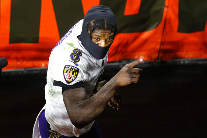 Baltimore Ravens quarterback Lamar Jackson looks up as he leaves the field after an NFL football game against the Cleveland Browns, Monday, Dec. 14, 2020, in Cleveland. The Ravens won 47-42. (AP Photo/Ron Schwane)