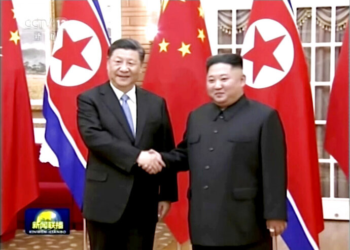 In this image taken from a video footage run by China's CCTV, Chinese President Xi Jinping, left, and North Korean leader Kim Jong Un, right, shake hands before their meeting in Pyongyang, North Korea, Thursday, June 20, 2019. Xi and Kim met in the North's capital on Thursday, their fifth meeting in 15 months, with stalled nuclear negotiations with Washington expected to be on the agenda. (CCTV via AP)