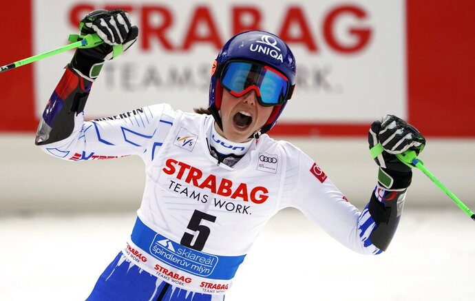 Slovakia's Petra Vlhova celebrates winning an alpine ski, women's World Cup giant slalom, in Spindleruv Mlyn, Czech Republic, Friday, March. 8, 2019. (AP Photo/Giovanni Auletta)
