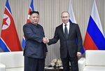 Russian President Vladimir Putin, right, and North Korea's leader Kim Jong Un posing for a photo prior to their talks in Vladivostok, Russia, Thursday, April 25, 2019. Putin and Kim are set to have one-on-one meeting at the Far Eastern State University on the Russky Island across a bridge from Vladivostok. The meeting will be followed by broader talks involving officials from both sides. (Alexei Nikolsky, Sputnik, Kremlin Pool Photo via AP)