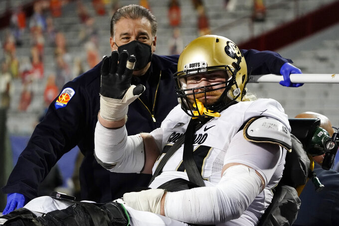 Colorado offensive lineman Chance Lytle (74) reacts while being carted off the field with an injury in the second half during an NCAA college football game against Arizona, Saturday, Dec. 5, 2020, in Tucson, Ariz. Colorado won 24-13. (AP Photo/Rick Scuteri)