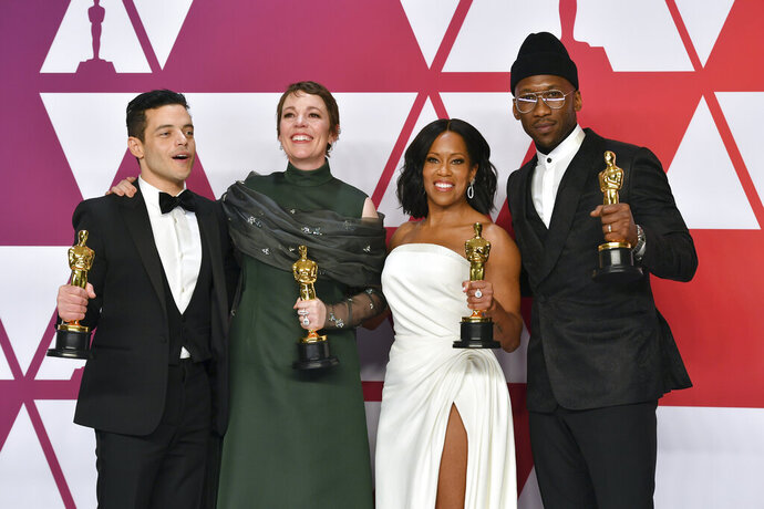 FILE - This Feb. 24, 2019 file photo shows Oscar winners, from left, Rami Malek, for best performance by an actor in a leading role for