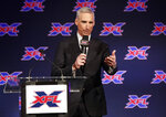 FILE - In this Feb. 7, 2019, file photo, Oliver Luck, XFL commissioner and CEO, makes comments during a news conference in Arlington, Texas, Thursday, Feb. 7, 2019. Gambling regulators and sports books in several U.S. states are preparing to allow gamblers to bet on XFL games once the league's season begins in early February 2020. (AP Photo/Tony Gutierrez, File)