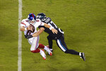 New York Giants' Daniel Jones (8) is tackled by Philadelphia Eagles' Nathan Gerry (47) during the second half of an NFL football game, Thursday, Oct. 22, 2020, in Philadelphia. (AP Photo/Derik Hamilton)
