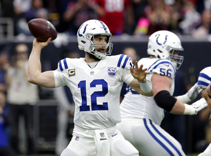 Indianapolis Colts quarterback Andrew Luck (12) throws against the Houston Texans during the first half of an NFL wild card playoff football game, Saturday, Jan. 5, 2019, in Houston. (AP Photo/Michael Wyke)