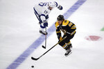 Boston Bruins right wing David Pastrnak (88) maneuvers away from Tampa Bay Lightning center Alex Killorn (17) during the second period of an NHL hockey game Thursday, Oct. 17, 2019, in Boston. (AP Photo/Elise Amendola)