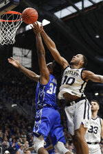 Butler forward Bryce Nze (10) blocks the shot over Creighton guard Denzel Mahoney (34) in the second half of an NCAA college basketball game in Indianapolis, Saturday, Jan. 4, 2020. Butler defeated Creighton 71-57. (AP Photo/Michael Conroy)