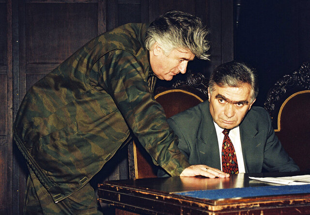 In this Sept. 1993 file photo, Bosnian Serb wartime leader Radovan Karadzic, left, and Serb member of Bosnian Presidency Momcilo Krajisnik in Banja Luka, Bosnia. The hospital in the northern Bosnian town of Banja Luka said Monday, Sept. 14, 2020, that Krajisnik, a former top wartime Bosnian Serb official who was convicted of war crimes by a U.N. court, died after contracting the new coronavirus. He was 75. (AP Photo/Radivoje Pavicic, File)