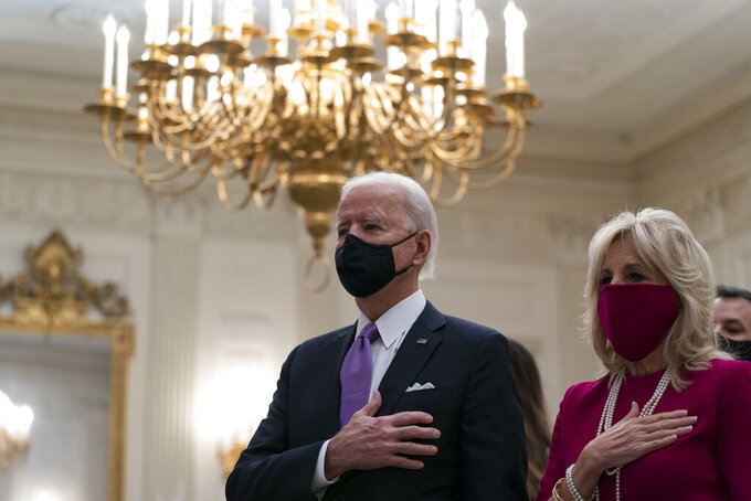 FILE- In this Thursday, Jan. 21, 2021 fiel photo, President Joe Biden, accompanied by first lady Jill Biden, places his hand over his heart during a performance of the national anthem, during a virtual Presidential Inaugural Prayer Service in the State Dinning Room of the White House, in Washington. Donald Trump's departure from the White House and the start of Biden's presidency have stirred new hopes among many religious leaders in the United States, while causing dismay among others. For leaders of the two largest Christian denominations — the Roman Catholic Church and the Southern Baptist Convention — the paramount concern about the Biden administration is its strong support for abortion rights.  (AP Photo/Alex Brandon, File)