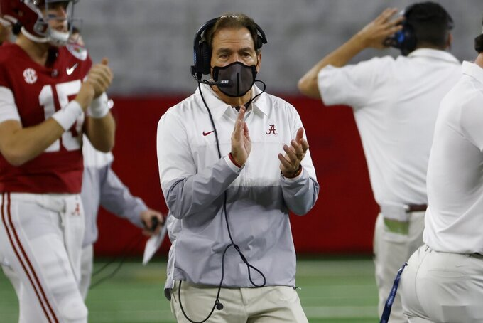 Alabama head coach Nick Saban applauds as he watches his team play Notre Dame late in the second half of the Rose Bowl NCAA college football game in Arlington, Texas, Friday, Jan. 1, 2021. (AP Photo/Ron Jenkins)