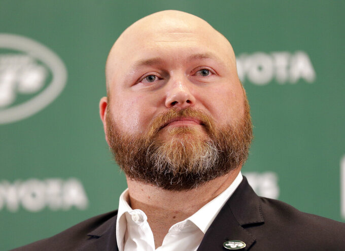 FILE - In this Tuesday, June 11, 2019, file photo, New York Jets general manager Joe Douglas speaks during a news conference at the team's NFL football training facility in Florham Park, N.J. Douglas' to-do list this 2021 offseason is massive, and so is the climb the New York Jets need to make to again reach respectability. (AP Photo/Seth Wenig, File)