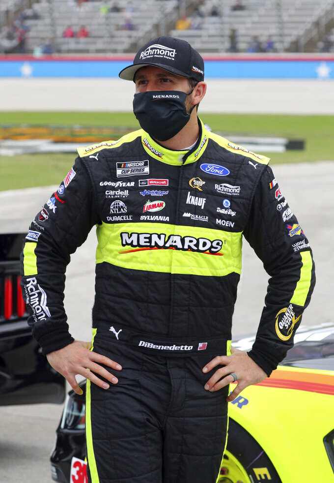 Matt DiBenedetto (21) waits on the grid before a NASCAR Cup Series auto race at Texas Motor Speedway in Fort Worth, Texas, Sunday, Oct. 25, 2020. (AP Photo/Richard W. Rodriguez)