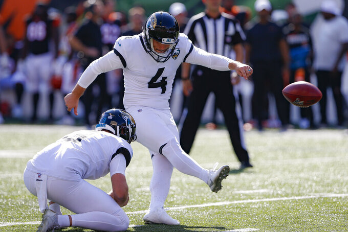 Jacksonville Jaguars kicker Josh Lambo (4) boots a field goal in the first half of an NFL football game against the Cincinnati Bengals, Sunday, Oct. 20, 2019, in Cincinnati. (AP Photo/Gary Landers)