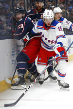 New York Rangers' Artemi Panarin, right, of Russia, chases the puck next to Columbus Blue Jackets' David Savard during the first period of an NHL hockey game Friday, Feb. 14, 2020, in Columbus, Ohio. (AP Photo/Jay LaPrete)