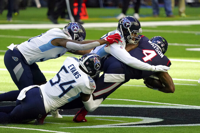 Houston Texans quarterback Deshaun Watson (4) is tackled by Tennessee Titans' Harold Landry III, right, Rashaan Evans (54) and Kevin Byard during the first half of an NFL football game Sunday, Jan. 3, 2021, in Houston. (AP Photo/Sam Craft)