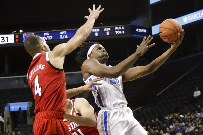 Memphis' Precious Achiuwa, right, drives past North Carolina State's Jericole Hellems during the first half of an NCAA college basketball game in the Barclays Classic, Thursday, Nov. 28, 2019, in New York. (AP Photo/Frank Franklin II)