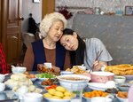 This image released by A24 films shows Zhao Shuzhen, left, and Awkwafina in a scene from
