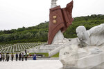 North Koreans visit the Fatherland Liberation War Martyrs Cemetery to pay respects to the monument to the fallen soldiers of the Korean People's Army in Pyongyang, North Korea, Thursday, June 25, 2020. North and South Korea on Thursday marked the 70th anniversary of the start of the Korean War with largely subdued commemorations amid the coronavirus pandemic, a day after the North abruptly halted a pressure campaign against the South. (AP Photo/Jon Chol Jin)