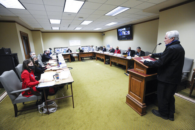 The House State Administration Committee hears testimony on HB 122, a bill seeking to revise the state's disaster and emergency services and executive power, Tuesday, Jan. 12, 2021, at the State Capitol in Helena, Mont. (Thom Bridge/Independent Record via AP)