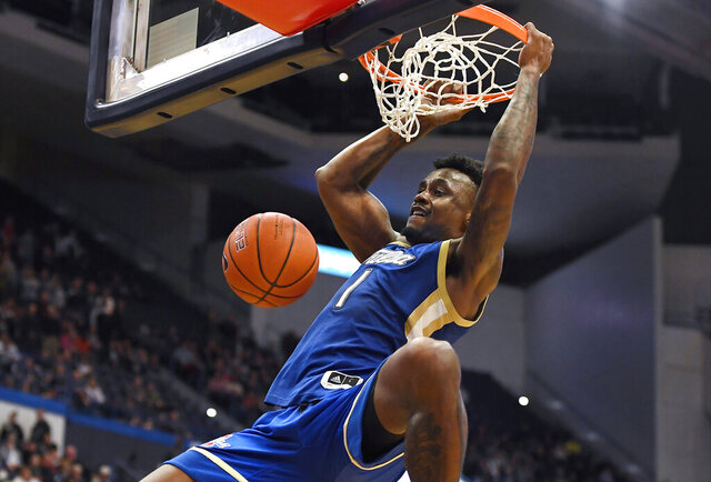 Tulsa's Martins Igbanu (1) dunks during overtime of an NCAA college basketball game against Connecticut, Sunday, Jan. 26, 2020, in Hartford, Conn. (AP Photo/Jessica Hill)