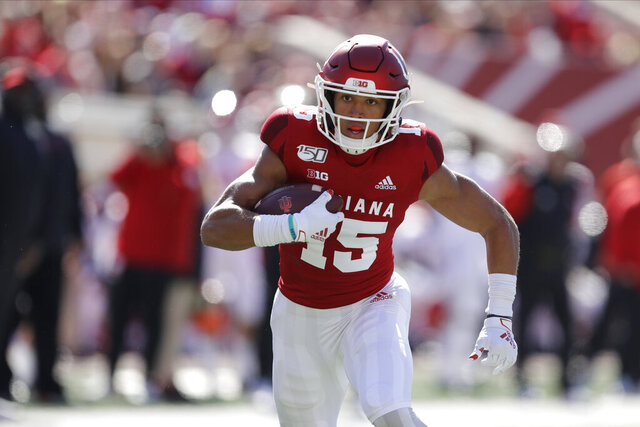 FILE - In this Oct. 12, 2019, file photo, Indiana wide receiver Nick Westbrook runs during the first half of an NCAA college football game against Rutgers, in Bloomington, Ind. Gone for the most part this year are access to in-person interviews, campus workouts and visits to team headquarters. Those who competed in college all-star games but didn't receive a combine invite, like Indiana receiver Nick Westbrook, have the advantage of performing in front of scouts. (AP Photo/Darron Cummings, File)