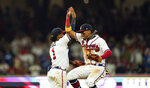 Atlanta Braves' Ozzie Albies, left, celebrates a win with Ronald Acuna Jr., right, after a baseball game against the Los Angeles Dodgers, Saturday, June 5, 2021, in Atlanta. (AP Photo/Brynn Anderson)