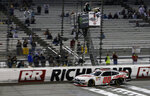 Cole Custer (00) crosses the finish line to win a NASCAR Xfinity Series auto race at Richmond International Raceway in Richmond, Va., Friday, April 12, 2019. (AP Photo/Steve Helber)