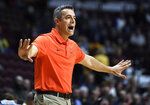Virginia head coach Tony Bennett reacts during the first half of an NCAA college basketball game against Arizona State, Sunday, Nov. 24, 2019, in Uncasville, Conn. (AP Photo/Jessica Hill)