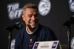 Virigina head coach Tony Bennett laughs during NCAA college basketball Atlantic Coast Conference media day, Tuesday, Oct. 12, 2021, in Charlotte, N.C. (AP Photo/Matt Kelley)